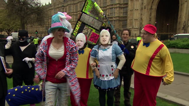 people dressed as characters from 'alice in wonderland' and a boris johnson impersonator outsider westminster on the day article 50 is triggered - alice in wonderland stock videos and b-roll footage