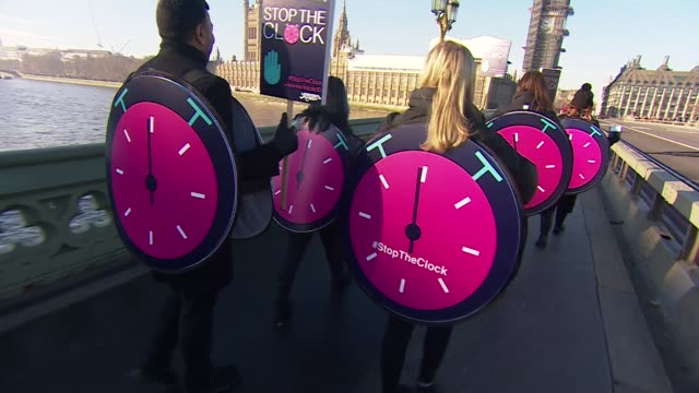 people dressed as clocks walking through westminster as they call for the government to delay brexit - clock stock videos & royalty-free footage