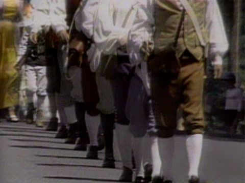 people dressed in 18th century costumes march through the town of havard to celebrate american independence day 4 july 1983 - 18th century stock videos & royalty-free footage