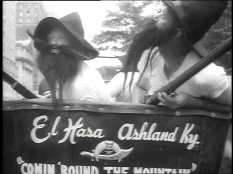 1951 montage people dressed in hillbilly costumes riding in old car / new york city, new york, united states - ヒルビリー点の映像素材/bロール