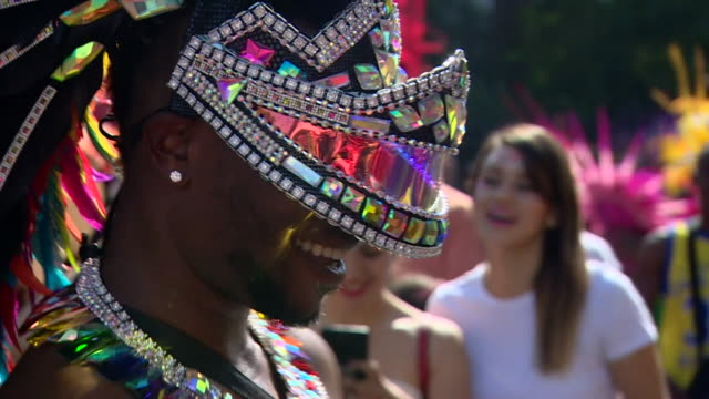 people dressed up for the notting hill carnival parade - multi coloured stock videos & royalty-free footage