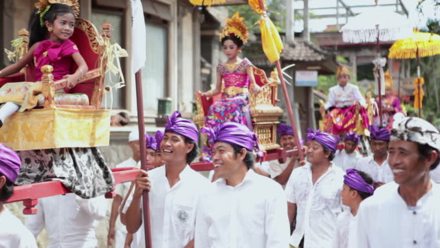 ms people dressed up with typical clothes walking in parade / bali, indonesia - sedan stock videos & royalty-free footage