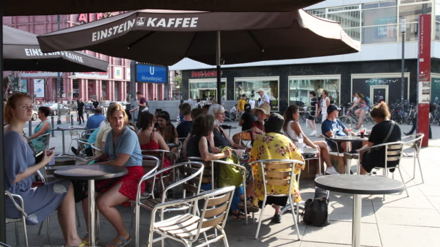 people drink coffee at alexanderplatz at temperatures above 30 degrees during the novel coronavirus pandemic on august 07, 2020 in berlin.... - coffee drink stock videos & royalty-free footage