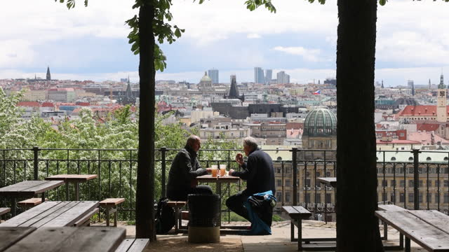 stockvideo's en b-roll-footage met people drinking at table in outdoor terrace cafe while czech republic reopens its cafes and restaurants, in stare mesto, prague, czech republic, on... - stare mesto