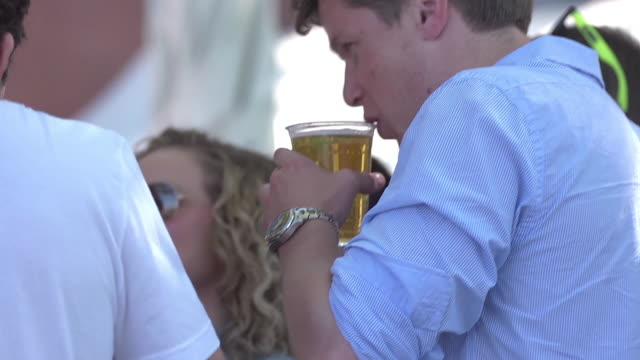 people drinking beer at outdoor bar - honour stock videos and b-roll footage