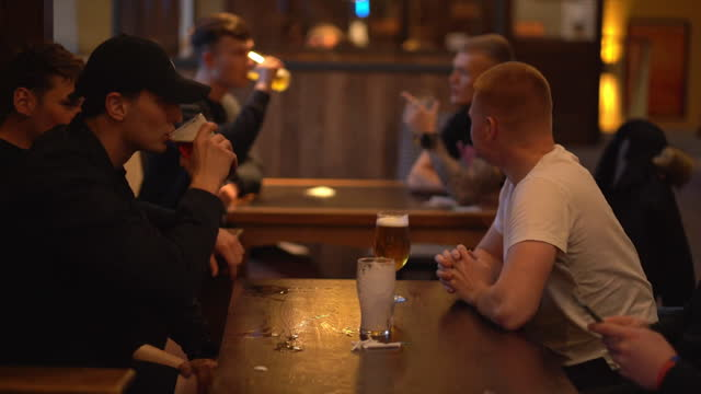 people drinking indoors at a pub in bury st edmunds as coronavirus lockdown restrictions ease - refreshment stock videos & royalty-free footage