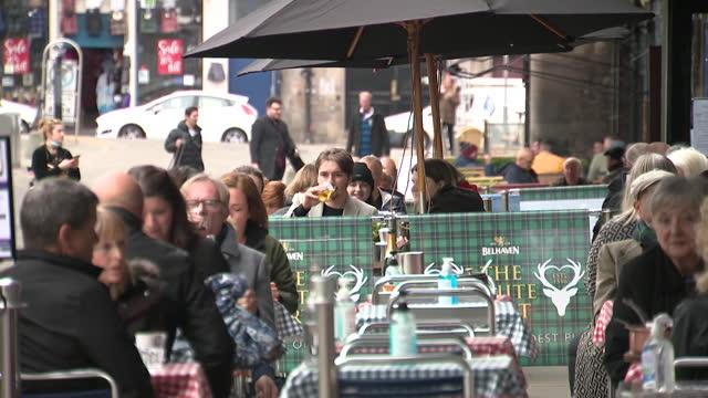 people drinking oustide pubs in edinburgh as coronavirus lockdown restrictions ease in scotland - outdoors stock videos & royalty-free footage