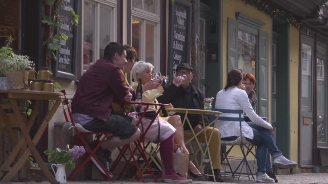 "people drinking wine in front of a shop at the ""merchants´bridge"" - german culture stock videos & royalty-free footage"
