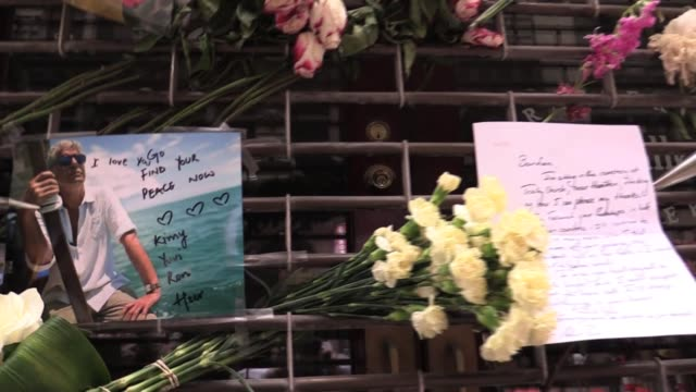 People dropping by flowers and notes at Anthony Bourdain's first restaurant Les Halles on John Street New York City