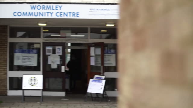 people dropping off coronavirus tests at wormley community centre in hertfordshire, in a bid to identify and isolate the south african variant - moving down stock videos & royalty-free footage