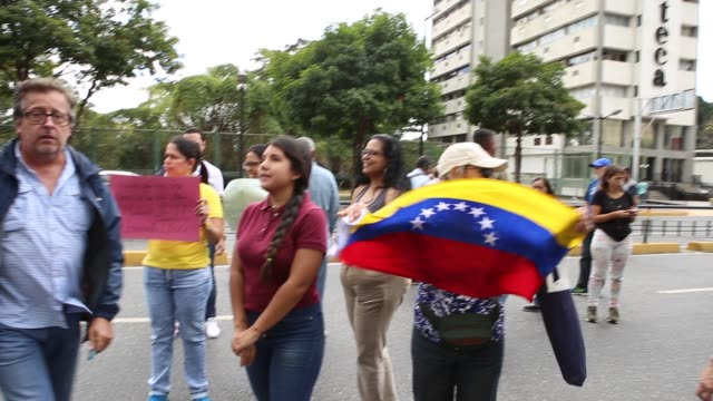 """People during a demonstration against the government of President Nicolás Maduro called by the opposition leader and selfproclaimed """"acting..."""