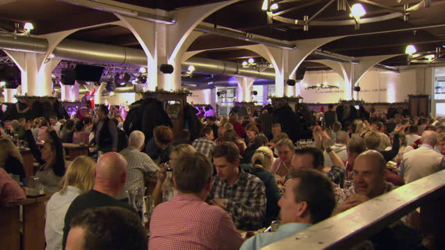 people eat and drink in beer hall, berlin - large group of people stock-videos und b-roll-filmmaterial