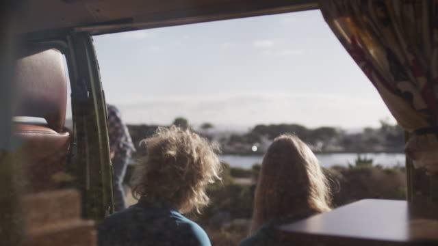 People eat breakfast in van, slow motion