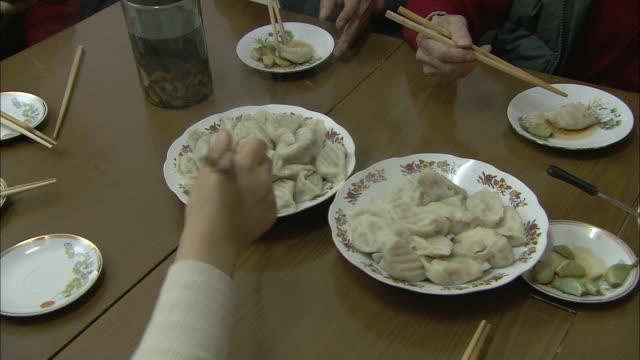 people eat dumplings with chopsticks in beijing. - chopsticks stock videos & royalty-free footage