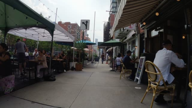 people eat in outdoor dining areas in the nolita neighborhood of manhattan as the city continues phase 4 of re-opening following restrictions imposed... - dining stock videos & royalty-free footage