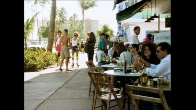 people eating and relaxing on ocean drive, florida; 1991 - wide shot stock videos & royalty-free footage