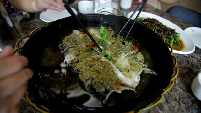 cu people eating chinese dish /xi'an, shaanxi, china - seafood stock videos & royalty-free footage