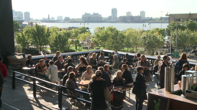 ms people eating in outdoor restaurant in highline park / new york, new york, united states - wide shot stock videos & royalty-free footage