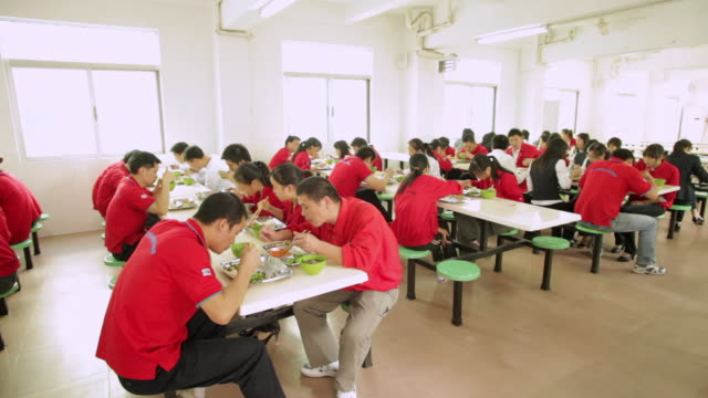 WS ZI People eating lunch at corporate cafeteria / Shenzhen, Guangdong, China