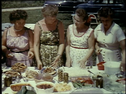 1957 montage people eating outside at picnic, food, the women in dresses / brussels, belgium - 1957 bildbanksvideor och videomaterial från bakom kulisserna