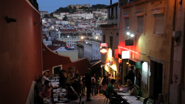 people eating outside lisbon restaurant at dusk bairro alto, lisbon, portugal, europe - lisbon stock videos and b-roll footage