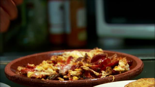montage people eating tapas, madrid, spain - tapas stock videos & royalty-free footage