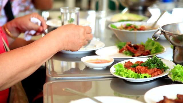 People eating Thai food in restaurant