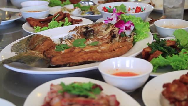 People eating Thai food in restaurant.