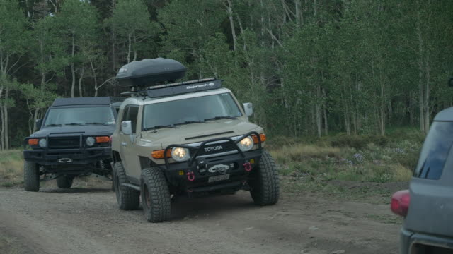 people engage in off roading with toyota fj cruiser vehicles in colorado amid 2020 coronavirus pandemic - land stock videos & royalty-free footage