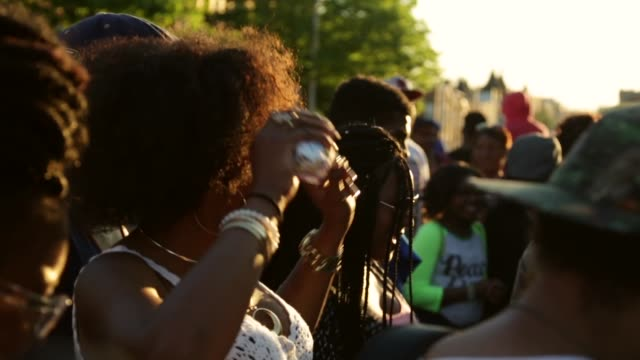people enjoy a concert near the intersection of w. north avenue and pennsylvania. baltimore, maryland. may 2, 2015. freddie gray was arrested for... - maryland us state stock videos & royalty-free footage