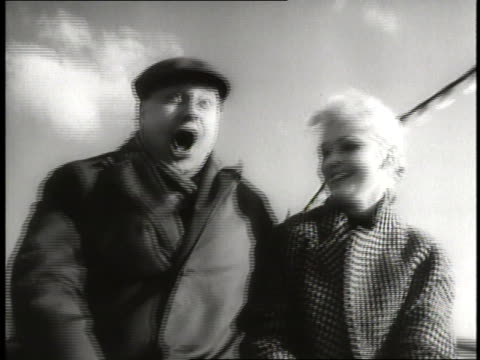 people enjoy a roller coaster ride at expo 58 in heysel park brussels belgium - anno 1958 video stock e b–roll