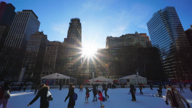 people enjoy ice skating at bryant park on sunday afternoon, amidst the covid-19 pandemic. - bryant park stock videos & royalty-free footage