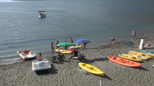 people enjoy on beach at mediterranean sea - paddle boat stock videos & royalty-free footage
