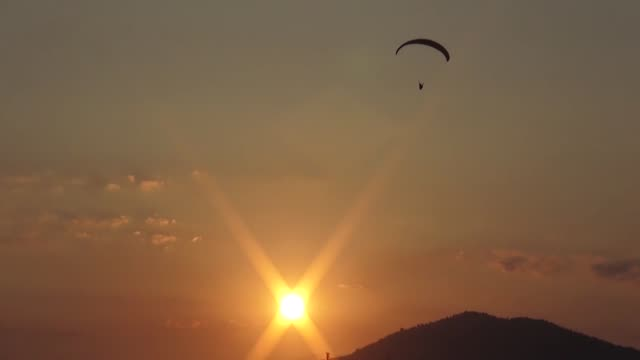 people enjoy paragliding from mount babadag over the mediterranean sea in fethiye district of turkey's southwestern mugla province on july 23 2019... - mugla province stock videos and b-roll footage