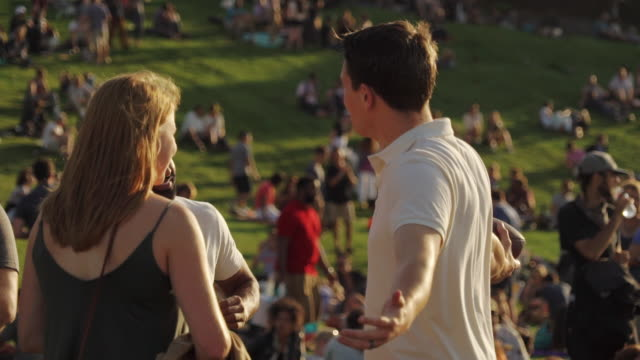 people enjoy sunny day in dolores park, san francisco usa - polo shirt stock videos & royalty-free footage