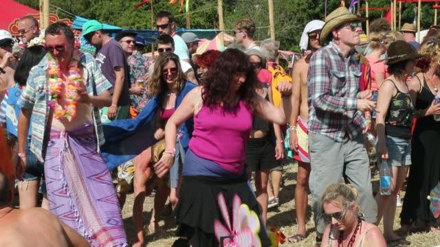 People enjoy the atmosphere at the Glastonbury Festival at Worthy Farm Pilton on June 27 2015 in Glastonbury England