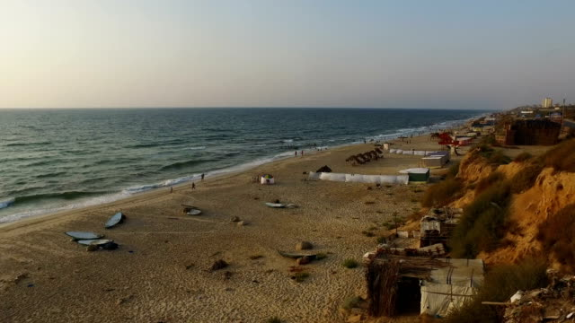 People enjoy the beach in the late afternoon on July 21 2017 in Gaza City Gaza For the past ten years Gaza residents have lived with constant power...