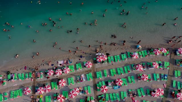 people enjoy the beach on august 16 2019 in oludeniz turkey turkey's resort towns saw a 100 percent occupancy rate with the eid aladha holiday... - oludeniz stock videos and b-roll footage