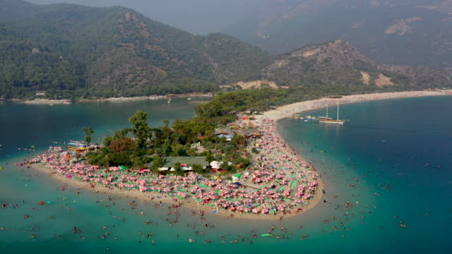 people enjoy the beach on august 16 2019 in oludeniz turkey turkey's resort towns saw a 100 percent occupancy rate with the eid aladha holiday... - ölüdeniz stock videos & royalty-free footage
