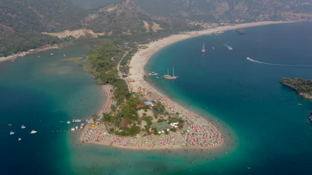 People enjoy the beach on August 16 2019 in Oludeniz Turkey Turkey's resort towns saw a 100 percent occupancy rate with the Eid alAdha holiday...