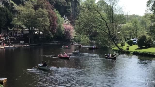 people enjoy the hot weather in the historic market town of knaresborough in north yorkshire boating on the river nidd and walking by the bridge - knaresborough stock videos & royalty-free footage