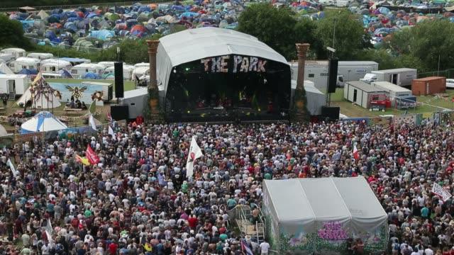 People enjoy the music at the Glastonbury Festival at Worthy Farm Pilton on June 27 2015 in Glastonbury England
