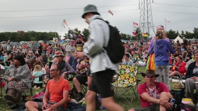 people enjoy the music at the glastonbury festival at worthy farm, pilton on june 27, 2015 in glastonbury, england. - お祭り好き点の映像素材/bロール