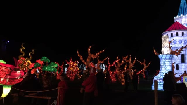people enjoy the spectacle at the opening night of annual festival of light at the elizabethan longleat house on november 3, 2017 in frome, england.... - red lake stock videos & royalty-free footage