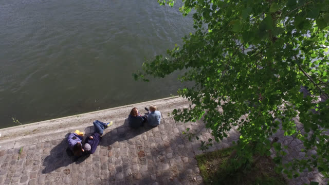 may 11: people enjoy the sun on the banks of the seine river on the ile saint louis, below quai d'orléans, 75004 paris, as france is slowly reopening... - five people stock videos & royalty-free footage