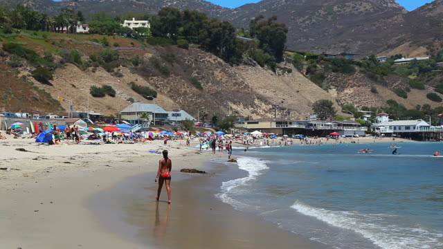 people enjoy time in malibu beach, pacific ocean, california, california on january 28, 2012 - malibu stock videos & royalty-free footage