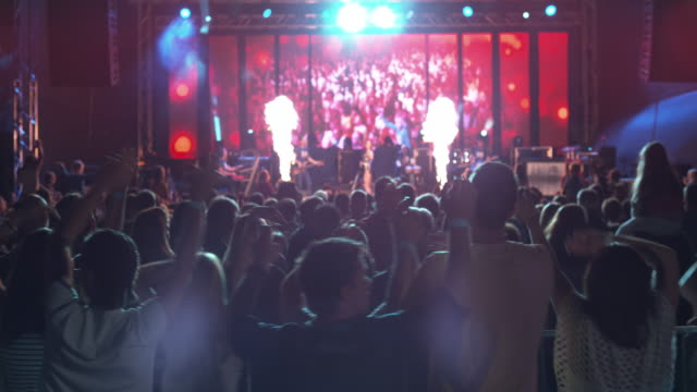 ds people enjoying a night concert outside - video wall stock videos & royalty-free footage