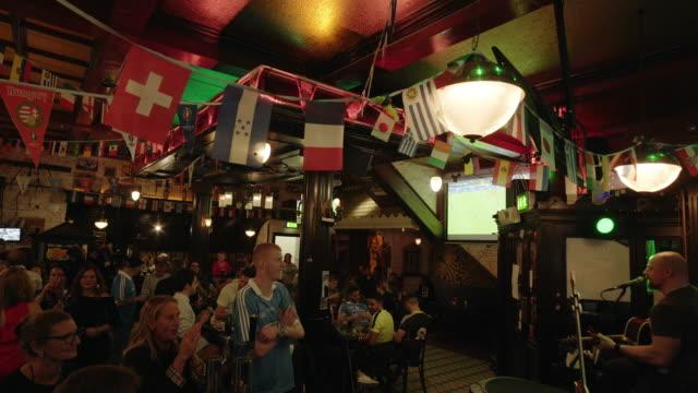 People Enjoying A Pub In Dublin Temple Bar Quarter