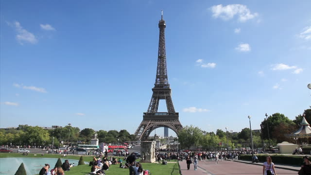 People enjoying a summers day at the Trocadero Gardens, Champs de Mars, in Paris.
