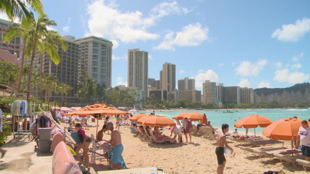 People enjoying at Waikiki beach in Honolulu, Hawaii
